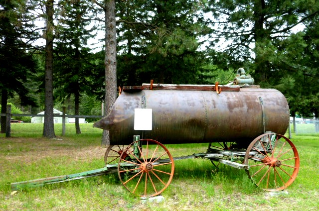 Hand Powered Pump on Horse Drawn Water Wagon Photo
